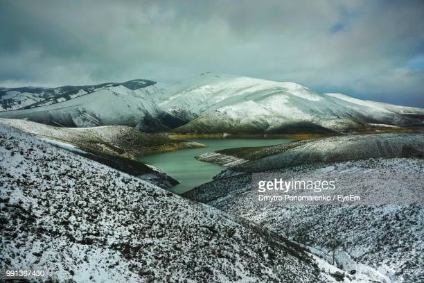 scenic view of snowcapped mountains against sky - zamora stock pictures, royalty-free photos & images