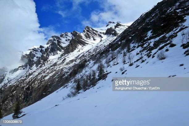 scenic view of snowcapped mountains against sky, swiss alps in spring from the train to jungfrau. - aungsumol stock pictures, royalty-free photos & images