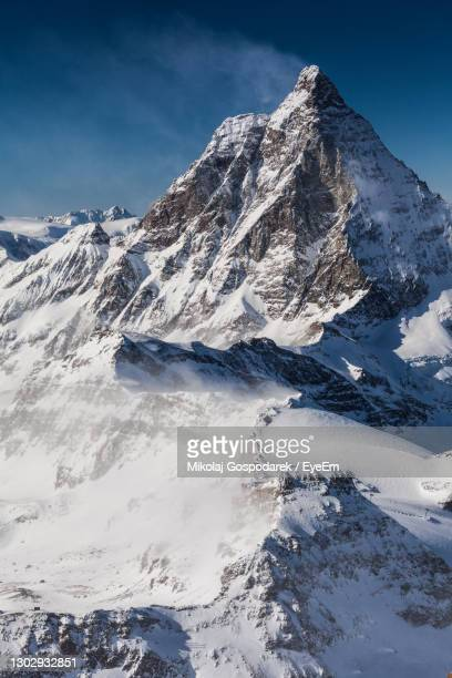 scenic view of snowcapped mountains against sky. view from klein matterhorn, swiss alps - klein foto e immagini stock