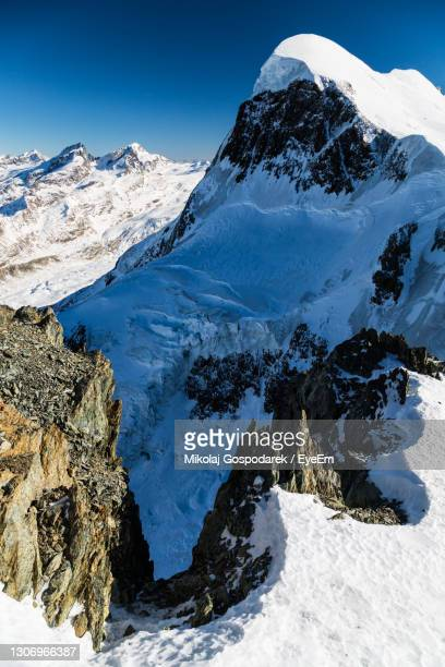 scenic view of snowcapped mountains against sky. view from klein matterhorn, zermatt - klein stock pictures, royalty-free photos & images