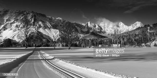 scenic view of snowcapped mountains against sky,gemeinde ramsau am dachstein,austria - andy dauer stock pictures, royalty-free photos & images