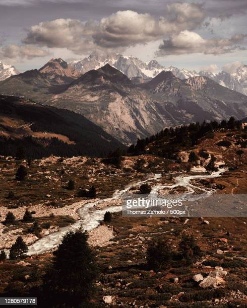 scenic view of snowcapped mountains against sky,la thuile,aosta valley,italy - la thuile foto e immagini stock