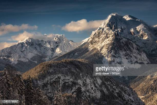scenic view of snowcapped mountains against sky,lofer,austria - andy dauer stock pictures, royalty-free photos & images