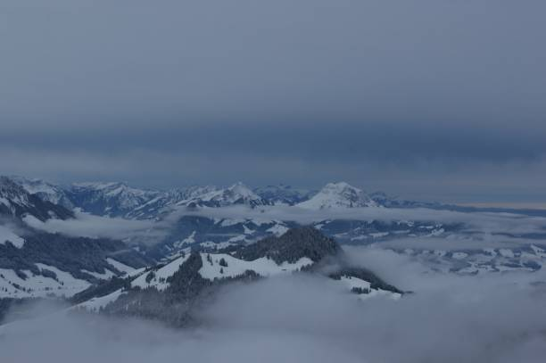 Scenic view of snowcapped mountains against sky,Route de la Berra,La Roche,Switzerland