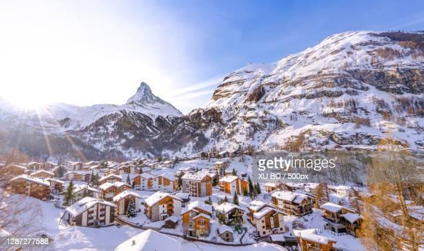 scenic view of snowcapped mountains against sky,zermatt,switzerland - zermatt stock pictures, royalty-free photos & images