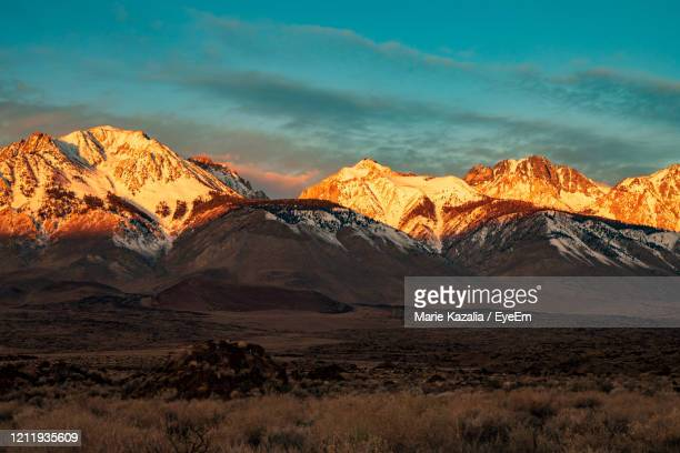 scenic view of snowcapped mountains against sunrise sky - golden hour stock pictures, royalty-free photos & images