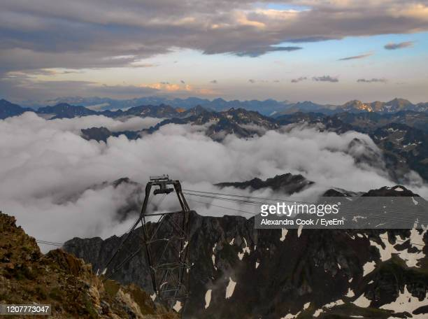 scenic view of snowcapped mountains and cable car against sky - バニェールドビゴール ストックフォトと画像