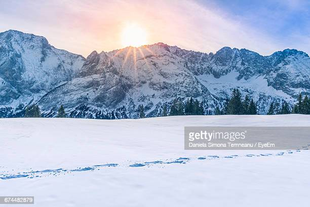 Scenic View Of Snowcapped Mountains And Footprints