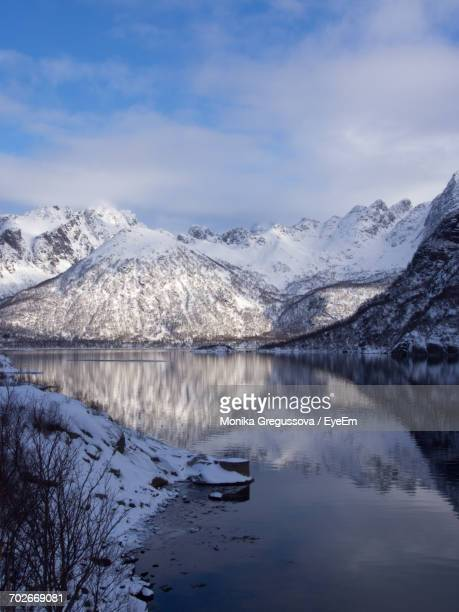 scenic view of snowcapped mountains and lake against sky - monika gregussova stock pictures, royalty-free photos & images