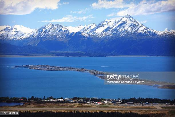 scenic view of snowcapped mountains by lake against sky - homer simpson fotografías e imágenes de stock