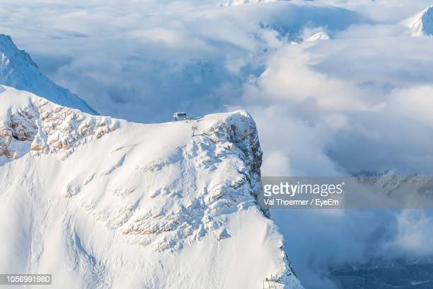 scenic view of snowcapped mountains during winter - garmisch partenkirchen stock pictures, royalty-free photos & images