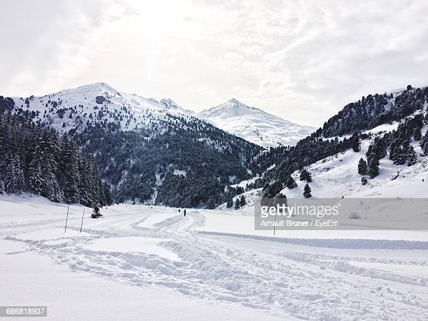 scenic view of snowcapped mountains - arnault stock pictures, royalty-free photos & images