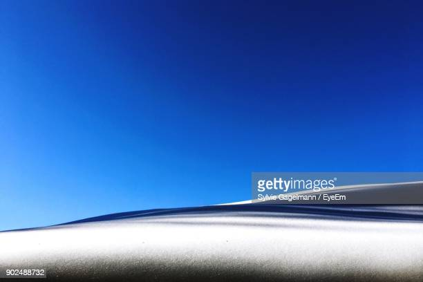 scenic view of snowfield against clear blue sky - snowfield stock pictures, royalty-free photos & images