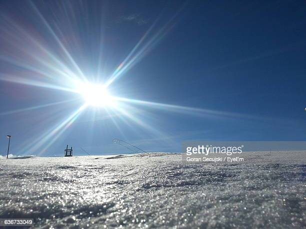 scenic view of snowy field against sky on sunny day - focus on background stock pictures, royalty-free photos & images