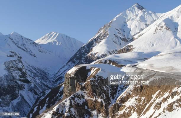 scenic view of snowy mountain - pinnacle rock formation stock-fotos und bilder
