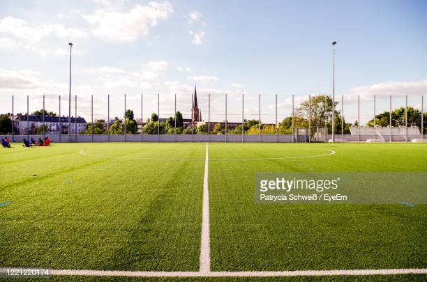 scenic view of soccer field against sky - football pitch stock pictures, royalty-free photos & images