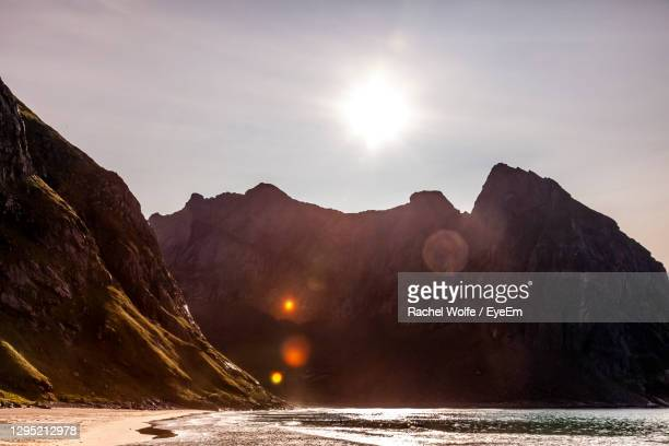 scenic view of solar rays over a mountain in the far north of norway. - rachel wolfe stock pictures, royalty-free photos & images