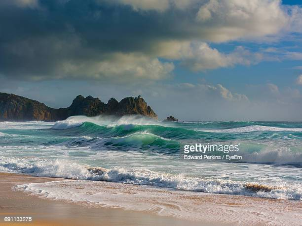 scenic view of splashing waves in sea against sky - seascape stock pictures, royalty-free photos & images