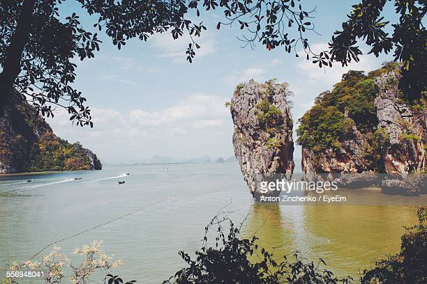scenic view of stack rocks in sea - zinchenko stock pictures, royalty-free photos & images