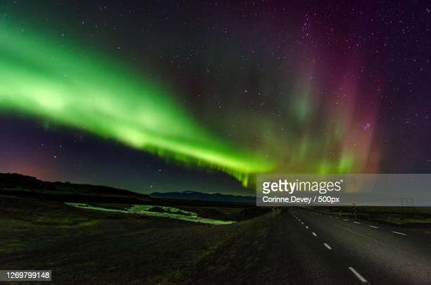 scenic view of star field against sky at night, akureyri, iceland - corinne paradis ストックフォトと画像
