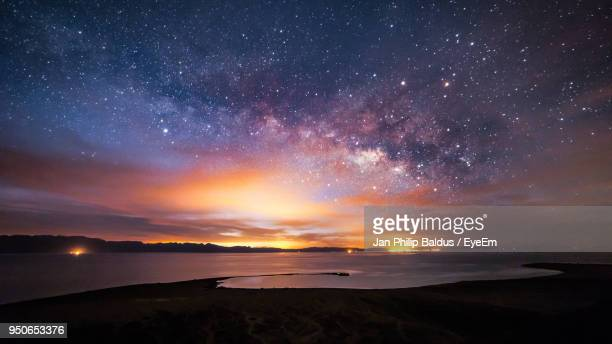 scenic view of star field at night - cielo stellato foto e immagini stock