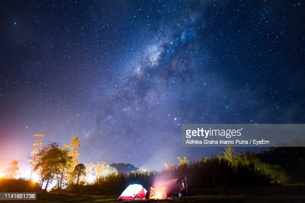scenic view of star field in sky at night - bandung stock pictures, royalty-free photos & images