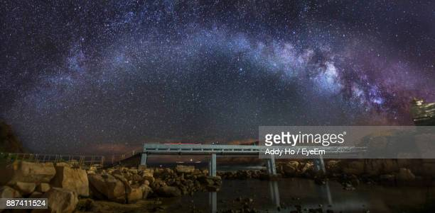 Scenic View Of Star Field On Bridge At Night