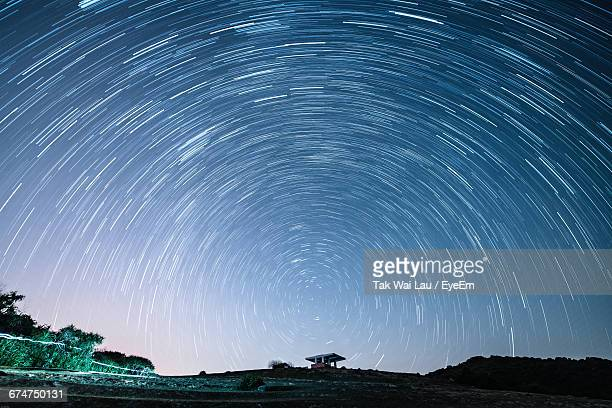 Scenic View Of Star Trails At Night