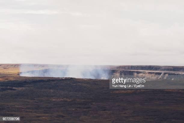 Scenic View Of Steam Emitting From Volcanic Landscape