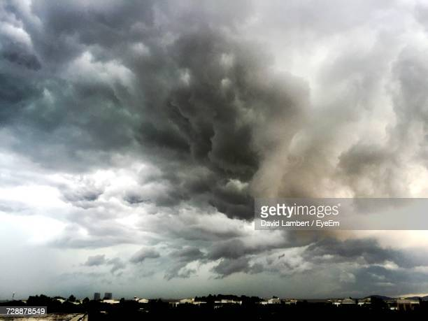 scenic view of storm clouds over dramatic sky - storm cloud stock pictures, royalty-free photos & images