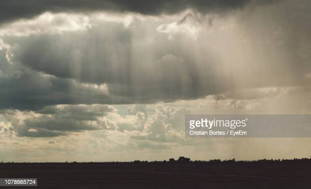 scenic view of storm clouds over land - bortes stockfoto's en -beelden