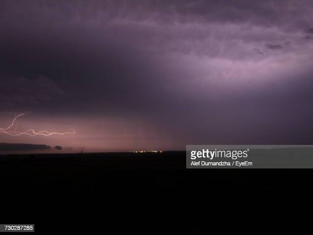 Scenic View Of Storm Clouds Over Landscape