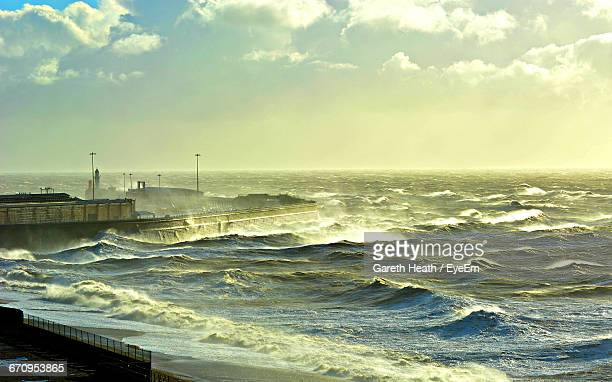 Scenic View Of Stormy Sea Against Sky