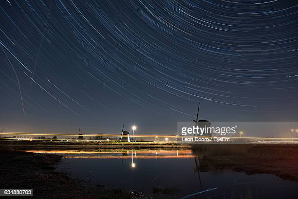 Scenic View Of Stream Against Star Trail At Night