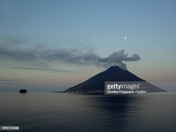 scenic view of stromboli island against sky - carolina fragapane stock pictures, royalty-free photos & images