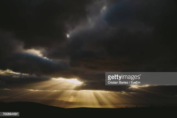 scenic view of sunlight emitting through clouds - bortes ストックフォトと画像