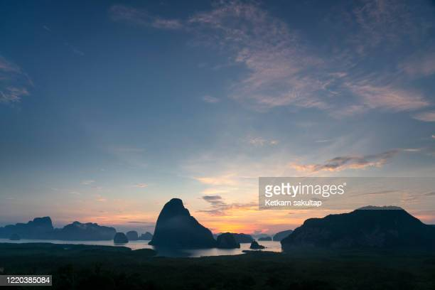 scenic view of sunrise at beautiful limestone island in phangnga bay, a view form samed nangchee view point. - インド洋 ストックフォトと画像