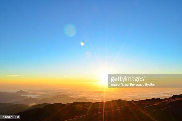 scenic view of sunrise - horizon over land stock photos and pictures