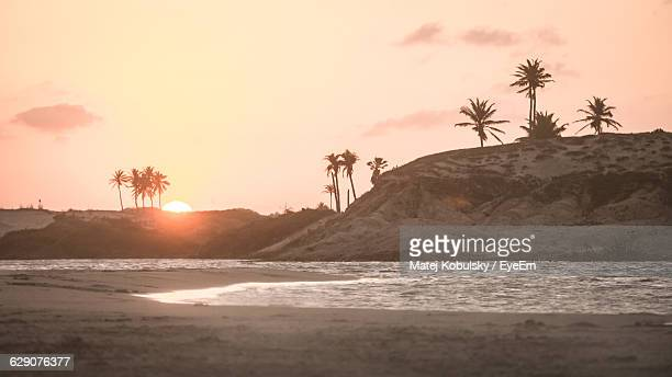 Scenic View Of Sunset At Beach