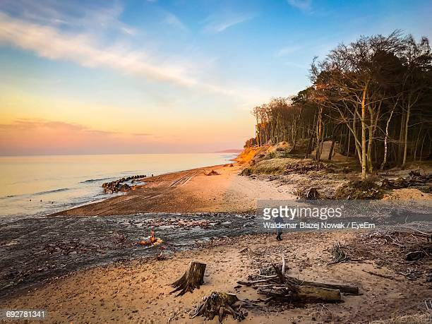 Scenic View Of Sunset At Dirty Beach Against Sky