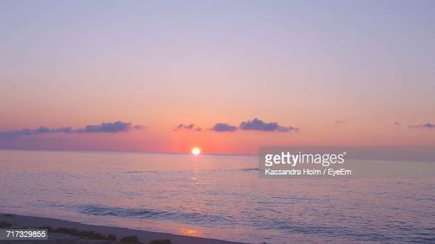 Scenic View Of Sunset Over Calm Sea
