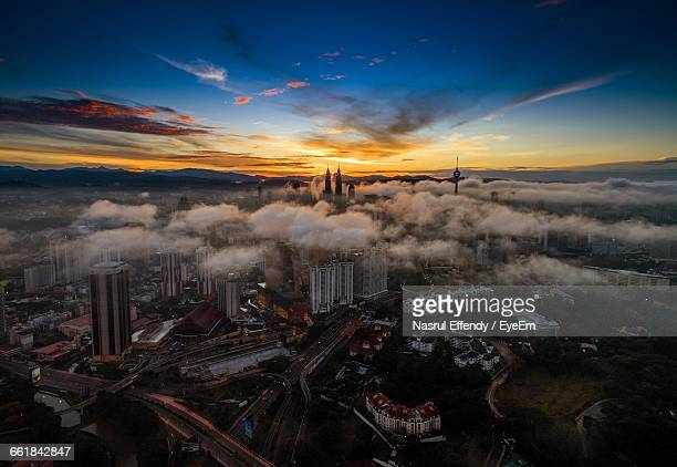 Scenic View Of Sunset Over City