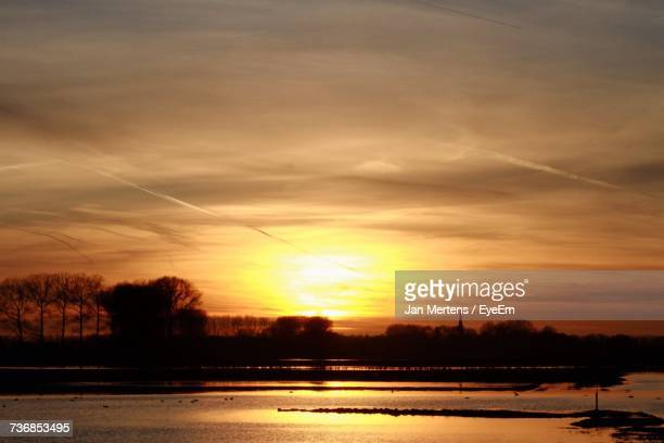 scenic view of sunset over lake - mertens stock pictures, royalty-free photos & images