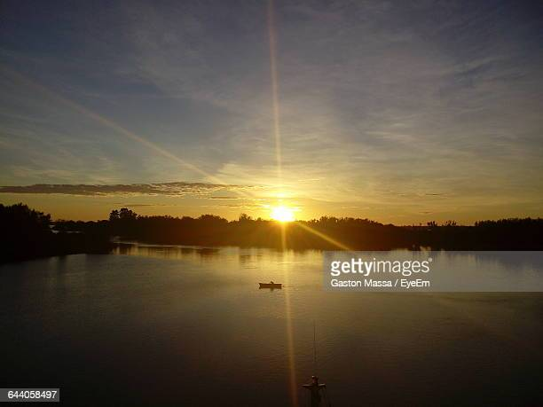 scenic view of sunset over river - massa stock pictures, royalty-free photos & images
