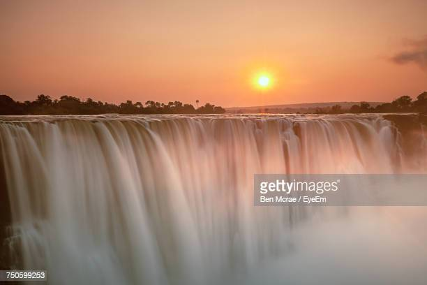 scenic view of sunset over river - zimbabwe stock pictures, royalty-free photos & images