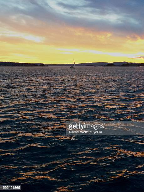 scenic view of sunset over sea against sky - rachel wolfe stock pictures, royalty-free photos & images