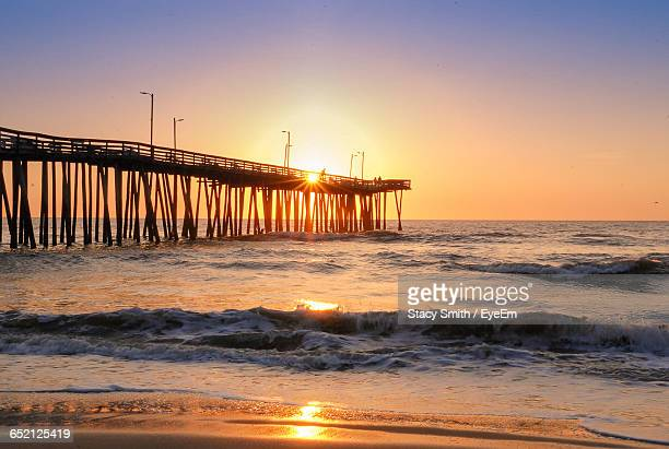 scenic view of sunset over sea - virginia beach stock photos and pictures