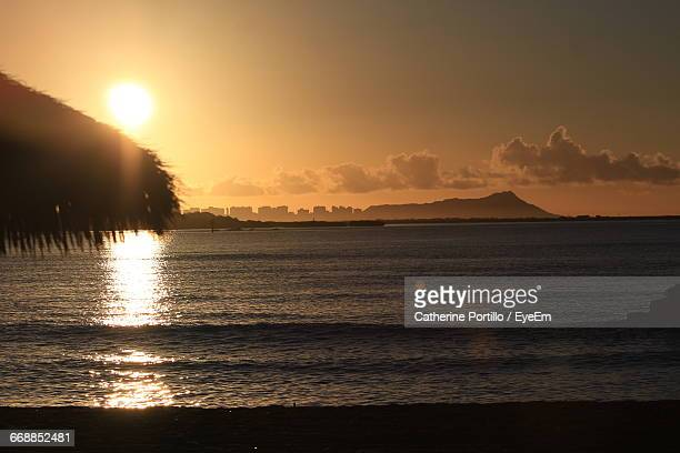 scenic view of sunset over sea - diamond head stock photos and pictures