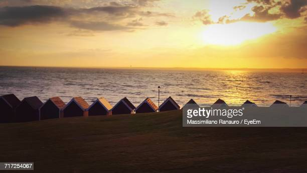scenic view of sunset over sea - massimiliano ranauro stock pictures, royalty-free photos & images