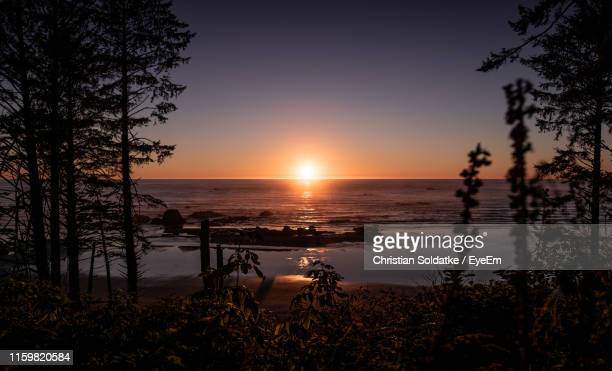 scenic view of sunset - christian soldatke stock pictures, royalty-free photos & images